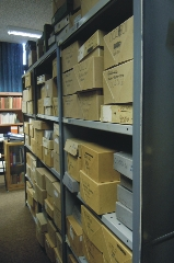 Original papers are catalogued and stored in boxes for easy reference